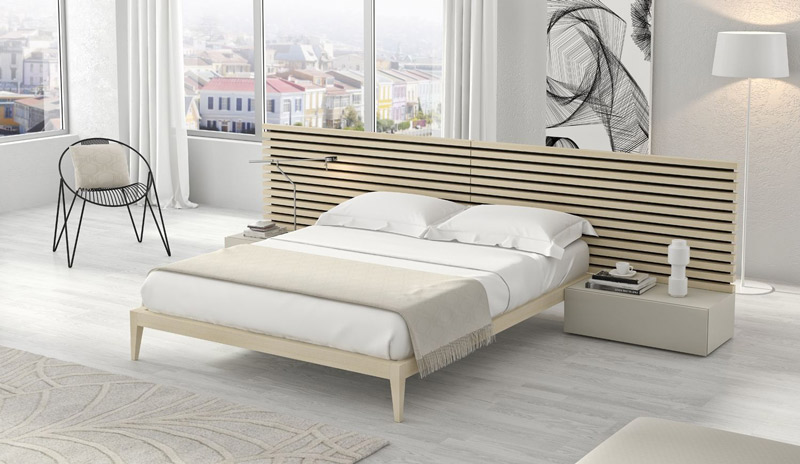 dormitorio moderno con cama con patas